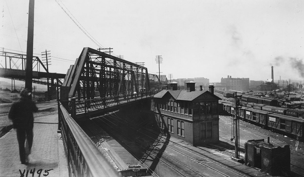 A pedestrian preparing to cross the Bluff Street Bridge into the West Bottoms, 1894