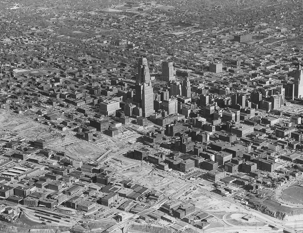 Aerial view of downtown captured early in the urban renewal era, showing evidence of building demolition and new construction, circa 1957. Kansas City Public Library.
