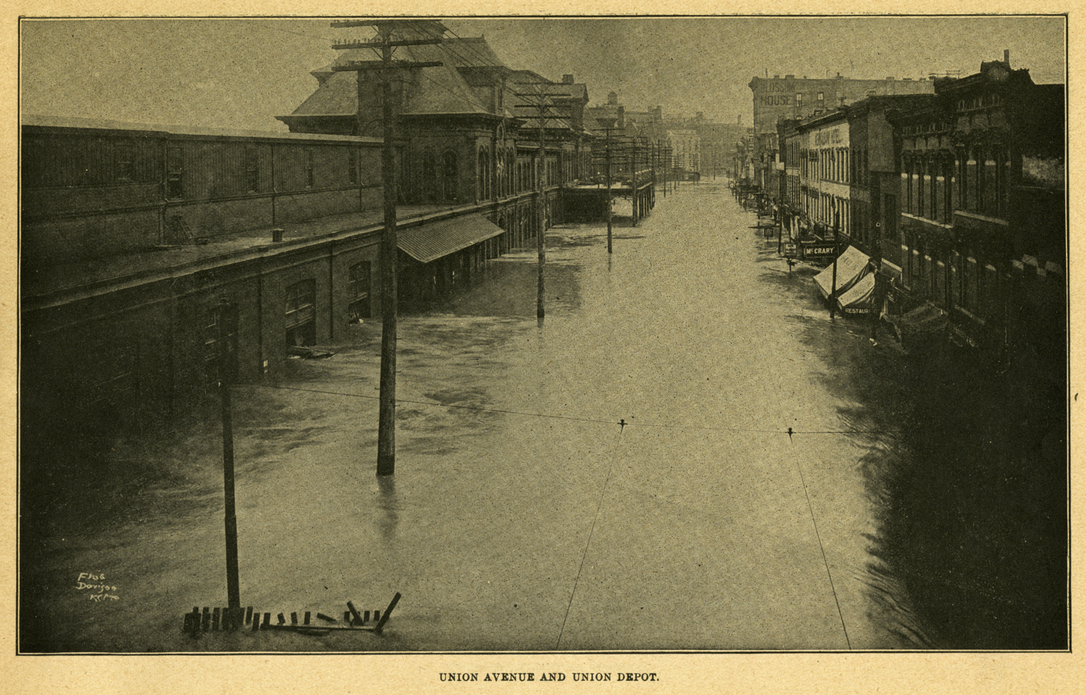 Union Avenue, its businesses, and the depot are overwhelmed by the 1903 Flood.