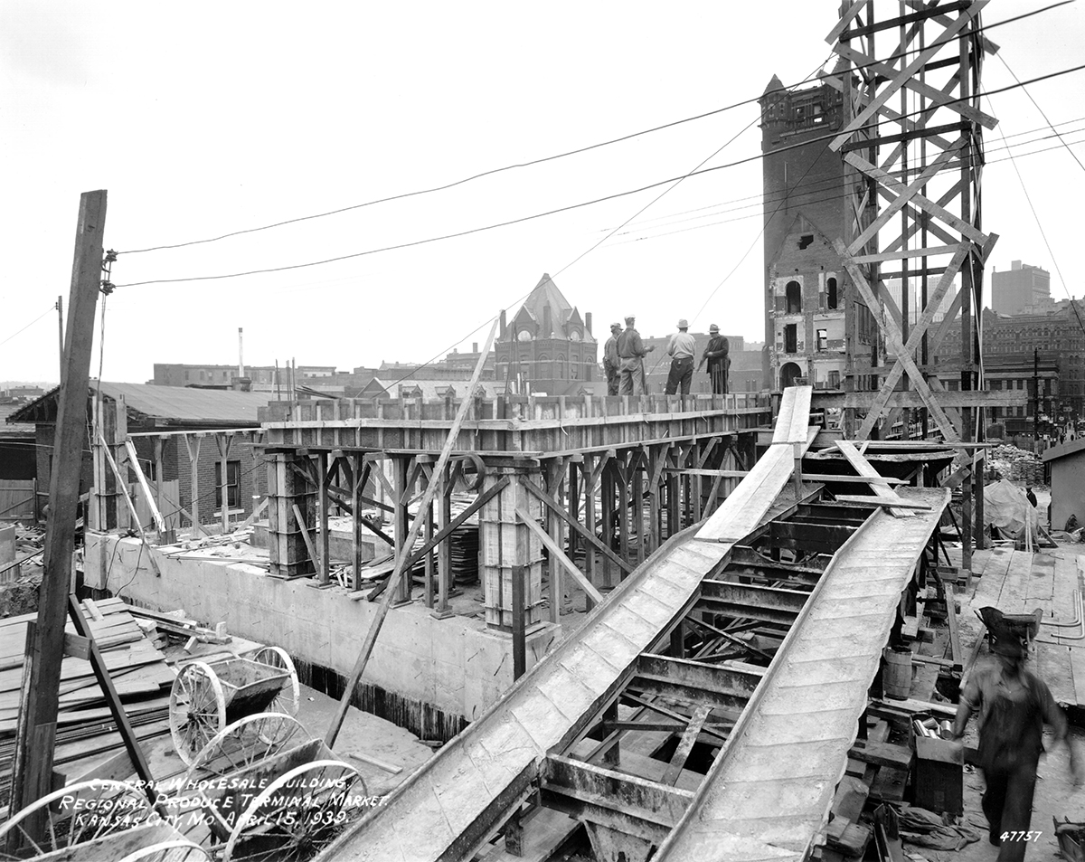 Construction of the new City Market with the tower from the old City Hall still standing in the background, 1939