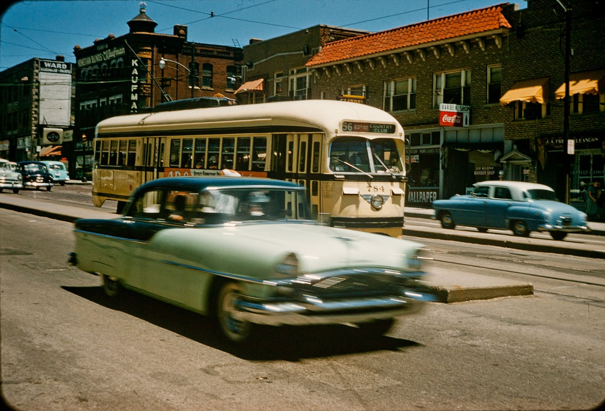 Color slide image of a streetcar on Main Street just south of 31st Street, dated June 19, 1957 – four days before service was discontinued. From the Dorothea Eldridge Slide Collection, Kansas City Public Library.