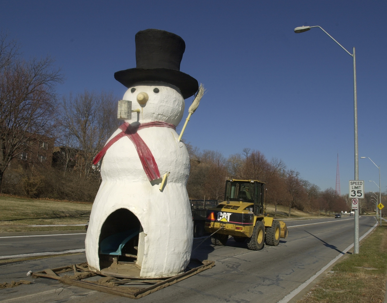 snowman being taken to his off-season home, 2002