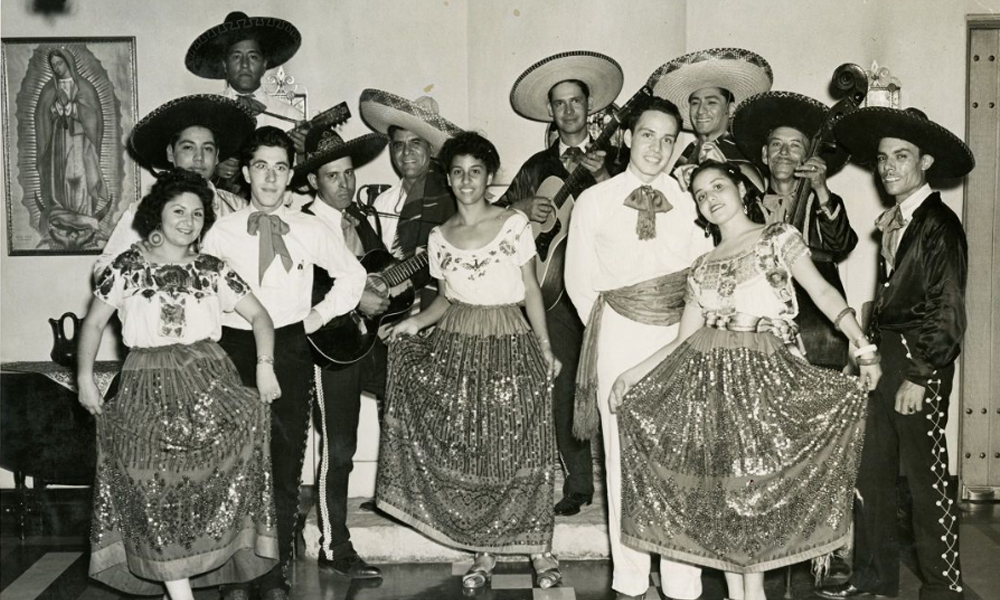 Photograph of dancers in traditional costumes and the Guadalupe Center Orchestra, circa 1941.