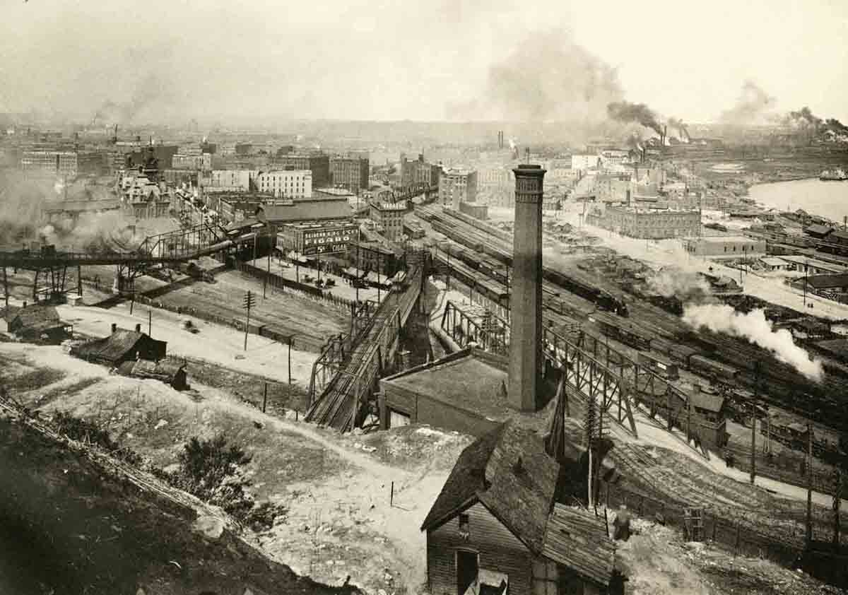 View looking down at the West Bottoms from Quality Hill showing the Ninth Street Incline and Eighth Street tunnel entering the bluffs, 1899