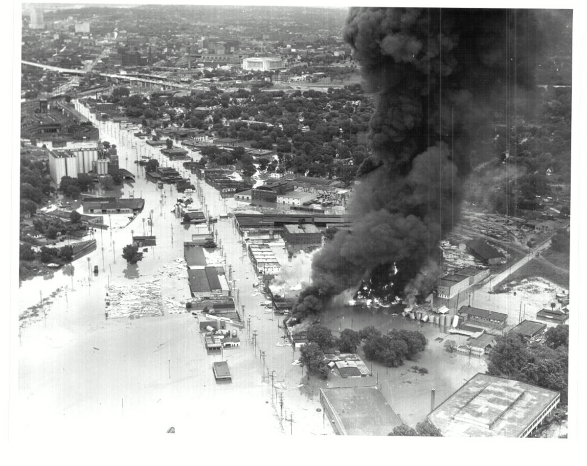Aerial view of Southwest Boulevard just east of the Kansas-Missouri Border, showing water and fire damage during the 1951 Flood. Missouri Valley Special Collections, Kansas City Public Library.