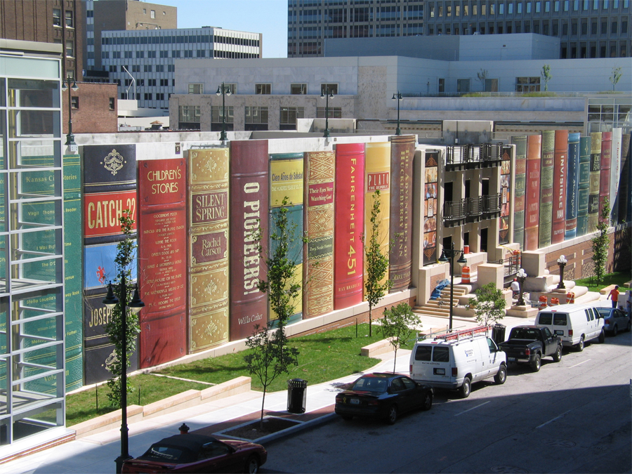 Image of the Library's parking garage which has book spines.