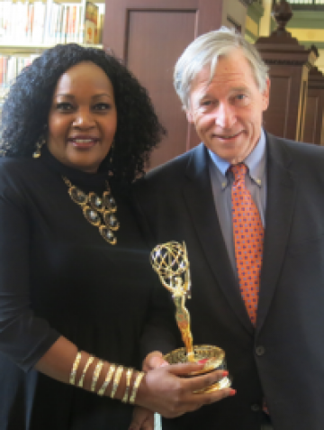Library Director of Strategic Initiatives Cheptoo Kositany-Buckner and Director Crosby Kemper III pose with the Library's second consecutive Emmy.