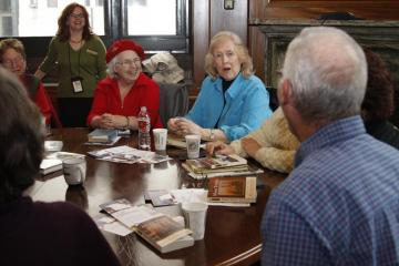 Readers gather in the President's Office to discuss Life on the Mississippi by Mark Twain