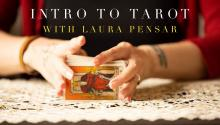 Hands on a table shuffling tarot cards